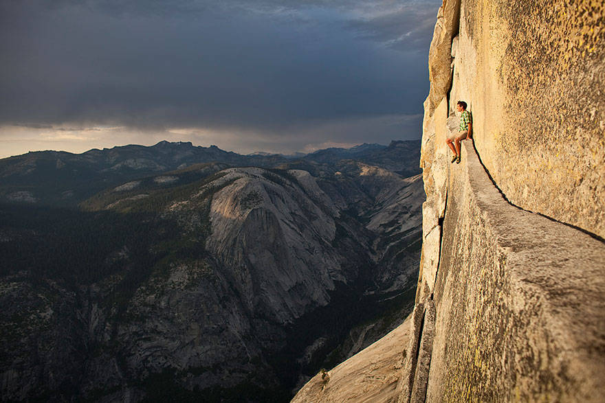 Alex Honnold, one of the world's most daring free-climbers, resting in the middle of a climb.