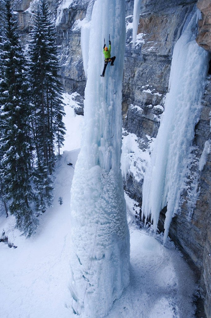 Ice climbing a waterfall.