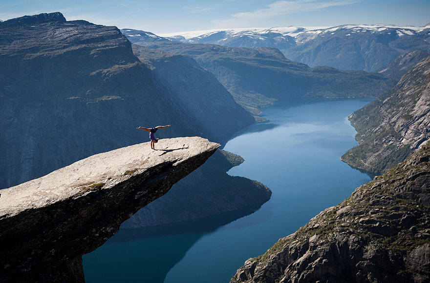 Doing some yoga on Norway's Trolltunga.