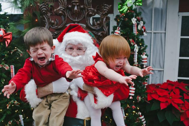 5. Getting a picture with Santa. Reality