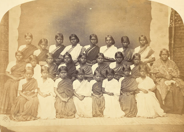 a group of 24 girls and their teacher at the London Mission Girls' Boarding School, Bangalore, taken by Henry Dixon in the 1860s