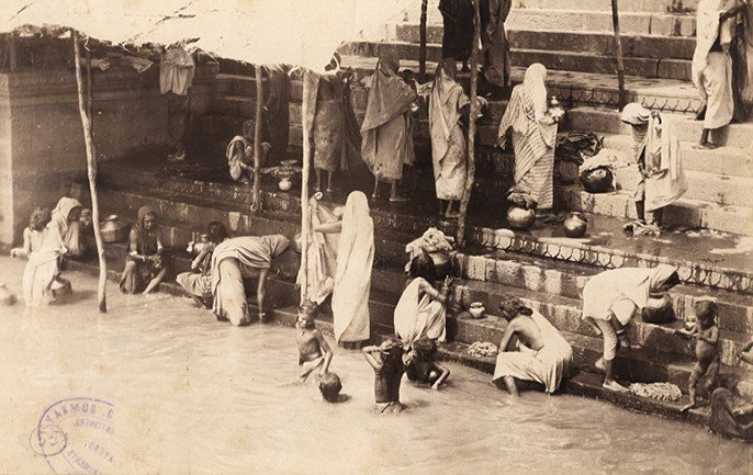 Bathing in the holy river Ganges, Benares, an albumen photo, c.1870-80