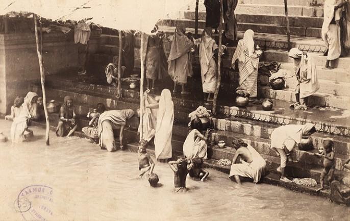 Bathing in the holy river Ganges, Benares, an albumen photo, c.1870-80