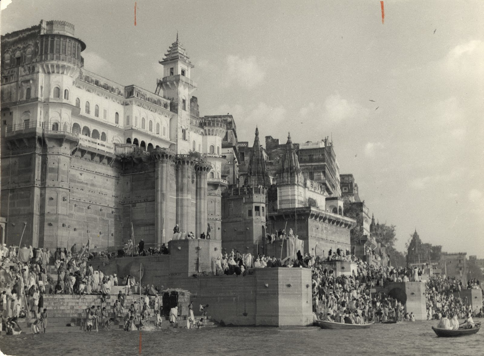 Hindu Pilgrims mass on the ghats on Ganges River at Banaras (Varanasi) under walls of palace during a festival - c1940-50's