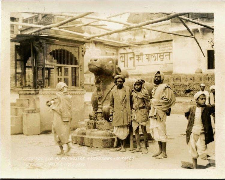 People standing in front of a Nandi statue - Benares (Varanasi) 1929