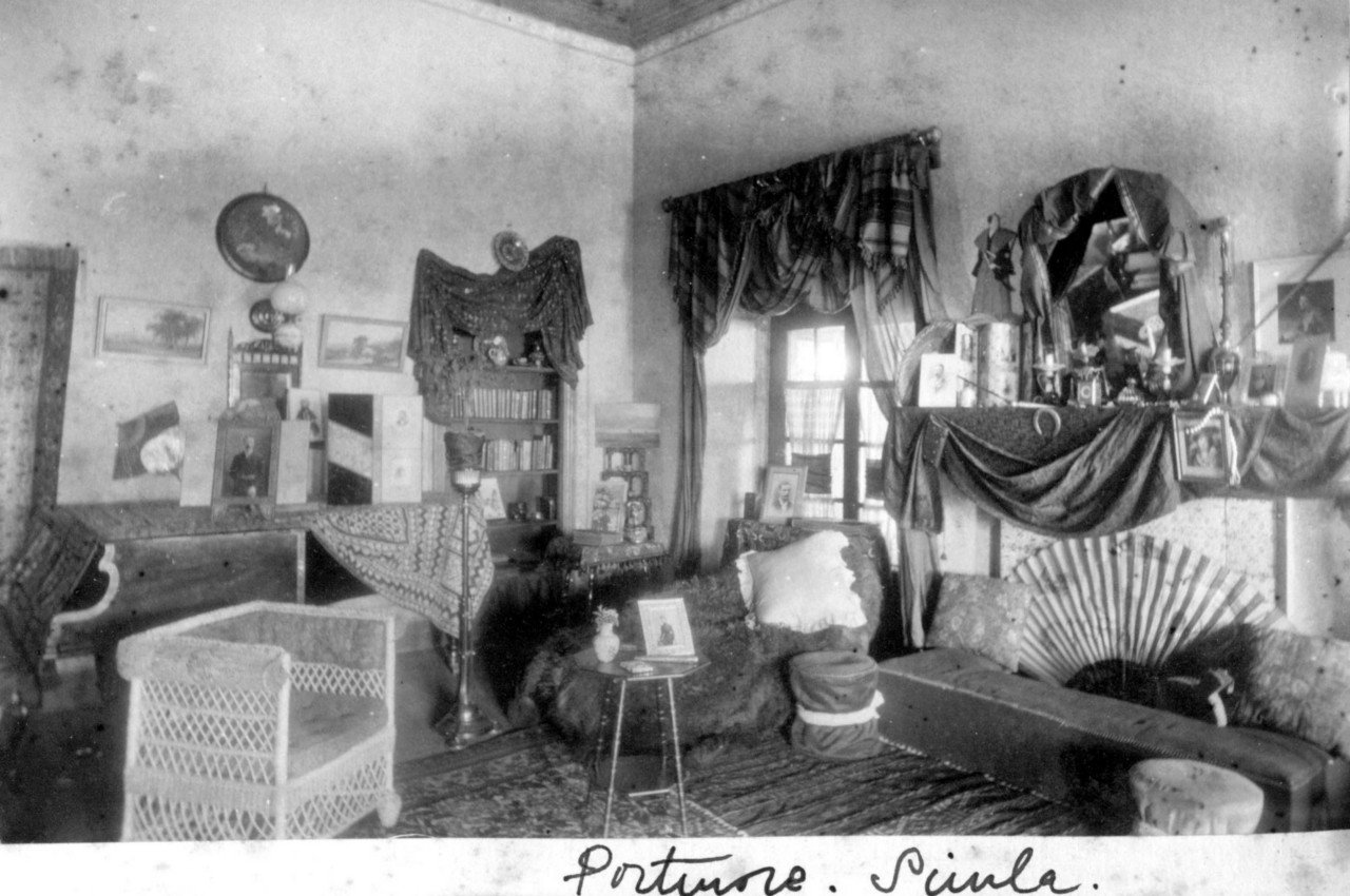 A Simla room maybe a sitting area in a lodging house, in a photo from 1890
