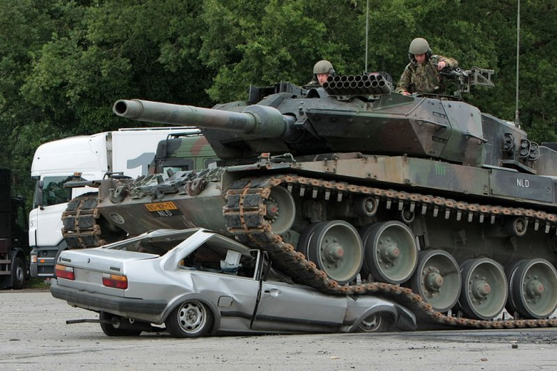 cool photos, tank photos, tank vs car, tank crushes car, germany, amry, military