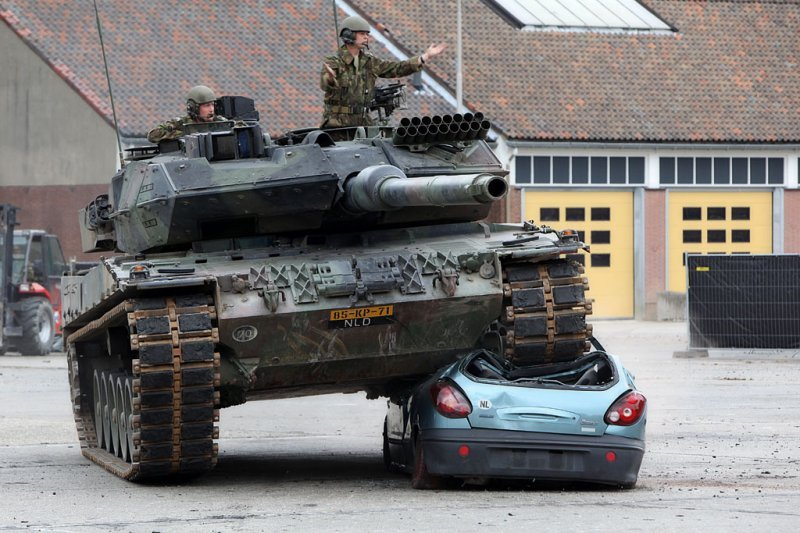 Drive A Tank >> 7 Cool Photos Shows How German Tank Crushes Car Brutally ...